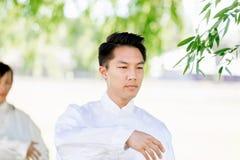 Handsome man practicing thai chi Stock Image