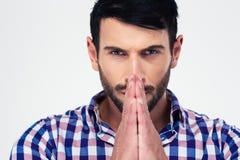 Handsome man praying Stock Photos