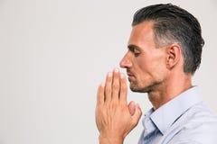 Handsome man praying Stock Images