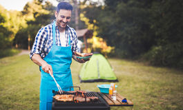 Handsome man preparing barbecue Royalty Free Stock Image