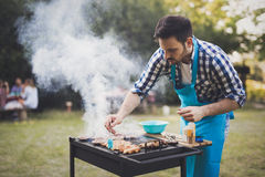 Handsome man preparing barbecue Stock Photography