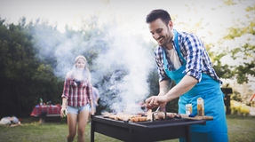 Handsome man preparing barbecue stock images