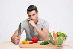 Handsome man preparing salad Royalty Free Stock Photo