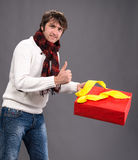 Handsome man with a present box Royalty Free Stock Images