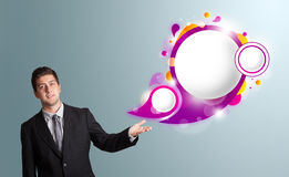 Handsome man presenting abstract speech bubble copy space Royalty Free Stock Images
