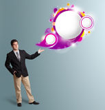 Handsome man presenting abstract speech bubble copy space Stock Images