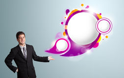 Handsome man presenting abstract speech bubble copy space Royalty Free Stock Photo