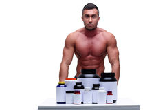 Handsome man presenting sports nutrition Stock Image