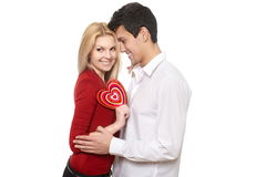 Handsome man presenting st valentine card to girl Stock Images
