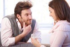 Handsome man proposing to woman. Handsome men proposing to women, giving engagement ring, smiling Royalty Free Stock Photography