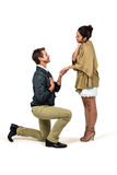 Handsome man proposing woman while kneeling Royalty Free Stock Photos