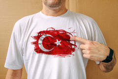 Handsome man proudly wearing white shirt with Turkish flag Royalty Free Stock Photos