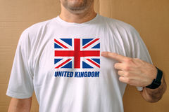 Handsome man proudly wearing white shirt with United Kingdom fla Royalty Free Stock Photography