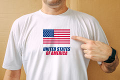 Handsome man proudly wearing white shirt with USA flag Stock Photo