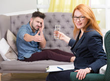 Handsome man at the psychotherapist Royalty Free Stock Photo