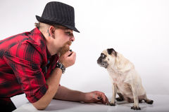 Handsome man with pug dog. Handsome Young man with cute Little pug dog stock image