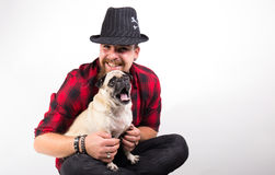 Handsome man with pug dog. Handsome Young man with cute Little pug dog yawning stock photography