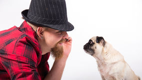 Handsome man with pug dog. Handsome Young man with cute Little pug dog yawning royalty free stock image
