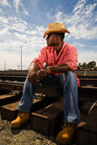 Handsome Man on Railroad Tracks Royalty Free Stock Images