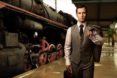 Handsome man on railway station Stock Photo