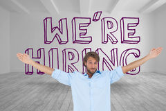 Handsome man raising arms in front of were hiring graphic Royalty Free Stock Image