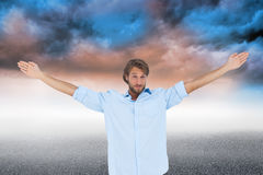 Handsome man raising hands Royalty Free Stock Photography