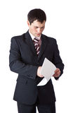 A handsome man is reading firm documents Stock Photos