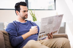 Handsome man reading the news Stock Image
