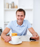 Handsome man reading newspaper Royalty Free Stock Photo