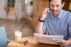 Handsome man reading a newspaper Royalty Free Stock Images