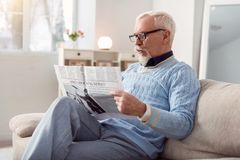 Handsome man reading newspaper in the morning Stock Photo