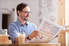 Handsome man reading newspaper Stock Photos