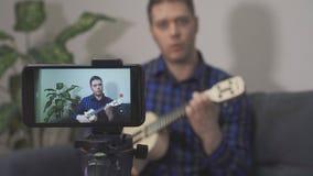 Handsome man recording song. Vlogging concept