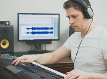 Handsome man recording song. Royalty Free Stock Photo
