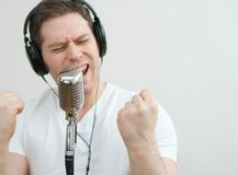 Handsome man recording a song. Royalty Free Stock Photography