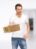 Handsome man with recyclable box. Picture of handsome man with recyclable box Stock Photos