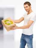 Handsome man with recyclable box Stock Images