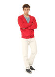 Handsome man in red cardigan and white pants isolated Royalty Free Stock Image
