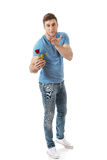 Handsome man with red rose. Stock Photography