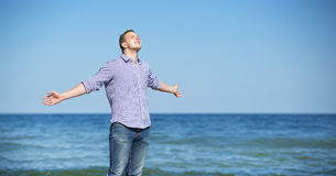 Handsome man relaxing on the beach Royalty Free Stock Photo