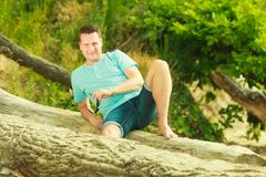 Handsome man relaxing on beach during summer. stock photography