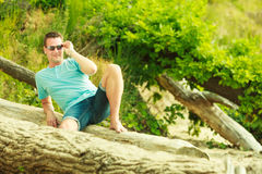 Handsome man relaxing on beach during summer. Royalty Free Stock Photography