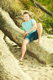 Handsome man relaxing on beach during summer. Stock Image