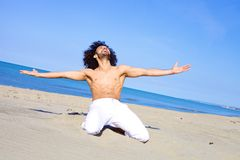 Handsome man relaxing on beach in vacation in summer Royalty Free Stock Image