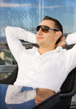 Handsome man relaxing in chair Royalty Free Stock Photos