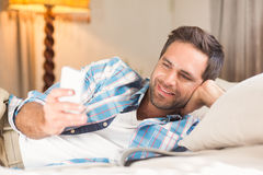 Handsome man relaxing on his bed Royalty Free Stock Photos