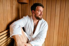 Handsome man relaxing in sauna. And staying healthy royalty free stock images