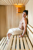 Handsome man relaxing in a sauna Stock Photo