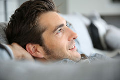 Handsome man relaxing on sofa Stock Image