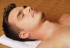 Handsome man relaxing at spa Stock Photo